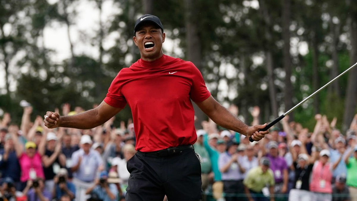 Tiger Woods reacts as he wins the Masters golf tournament Sunday, April 14, 2019, in Augusta,...